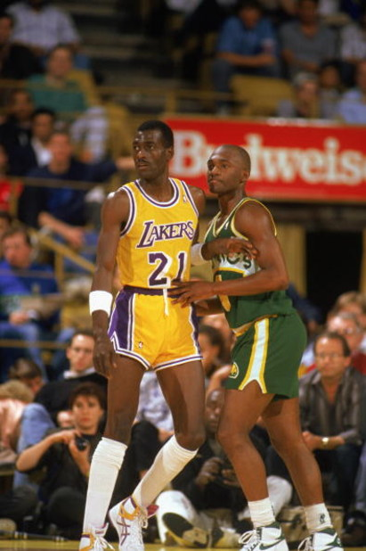 LOS ANGELES - 1990:  Sedale Threatt #4 of the Seattle Supersonics and Michael Cooper #21 of the Los Angeles Lakers battle for position during a game in the 1989-1990 NBA season at the Great Western Forum in Los Angeles, California.  (Photo by Ken Levine/G