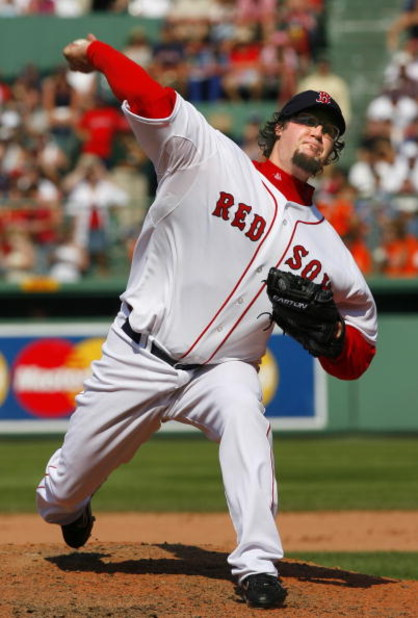 BOSTON - AUGUST 2:  Eric Gagne #83 of the Boston Red Sox pitches against the Baltimore Orioles on August 2, 2007 at Fenway Park in Boston, Massachusetts. (Photo by Jim Rogash/Getty Images)