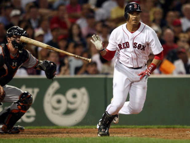 BOSTON - SEPTEMBER 08:  Victor Martinez #41 of the Boston Red Sox drives in a run as Matt Wieters #15 of the Baltimore Orioles defends on September 8, 2009 at Fenway Park in Boston, Massachusetts.  (Photo by Elsa/Getty Images)