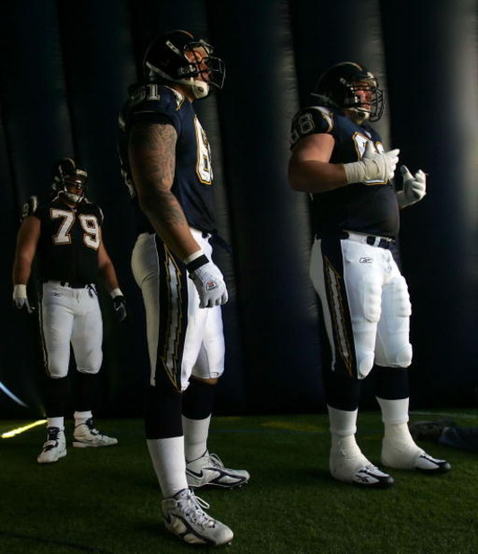 SAN DIEGO, CA - OCTOBER 29:   (L-R) Mike Goff #79, Nick Hardwick #61 and Kris Dielman #68 of the San Diego Chargers wait to be introduced before taking on the St. Louis Rams on October 29, 2006 at Qualcomm Stadium in San Diego, California.  The Chargers w
