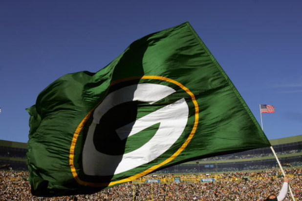 GREEN BAY, WI - OCTOBER 29:  A Green Bay Packers flag is waved during a game against the Arizona Cardinals at Lambeau Field on October 29, 2006 in Green Bay Wisconsin.  The Packers won 31-14.  (Photo by Stephen Dunn/Getty Images)