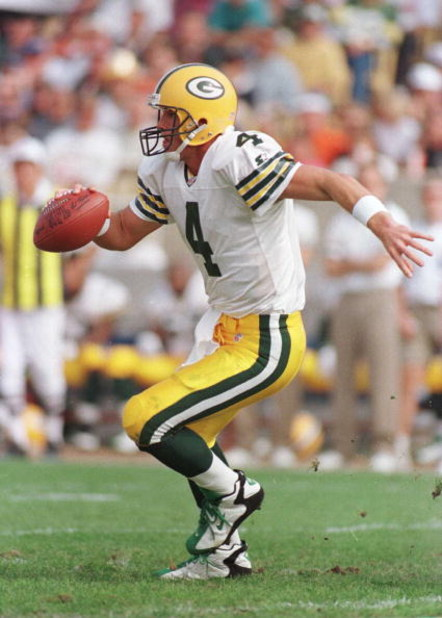 6 Oct 1996:  Quarterback Brett Favre #4 of the Green Bay Packers scrambles in the second quarter during the Packers 37-6 win over the Chicago Bears at Soldier Field in Chicago, Illinois. Mandatory Credit: Jonathan Daniel/Allsport