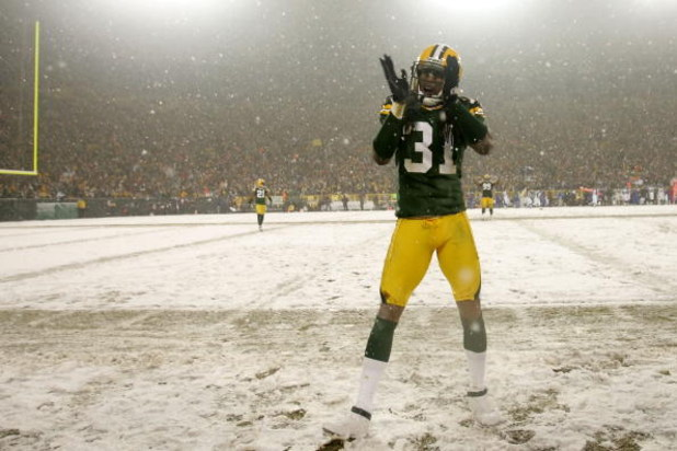 GREEN BAY, WI - JANUARY 12:  Cornerback Al Harris #31 of the Green Bay Packers cheers from the sideline in the fourth quarter against the Seattle Seahawks during the NFC divisional playoff game on January 12, 2008 at Lambeau Field in Green Bay, Wisconsin.