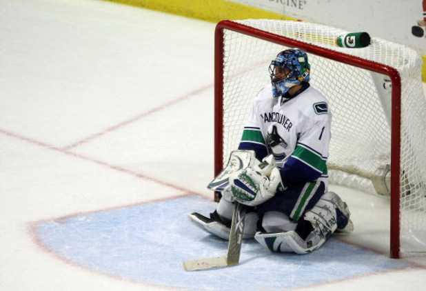 CHICAGO - MAY 11:  Goalie Roberto Luongo #1 of the Vancouver Canucks sits on the ice after he gave up a hat trick goal to Patrick Kane #88 of the Chicago Blackhawks in the third period during Game Six of the Western Conference Semifinal Round of the 2009