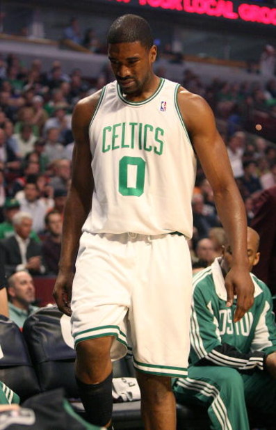CHICAGO - MARCH 17: Leon Powe #0 of the Boston Celtics tests out an injured knee near the bench during a game against the Chicago Bulls on March 17, 2009 at the United Center in Chicago, Illinois. NOTE TO USER: User expressly acknowledges and agreees that