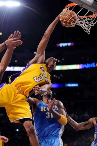 LOS ANGELES, CA - MAY 21:  Trevor Ariza #3 of the Los Angeles Lakers dunks the ball against Nene #31 of the Denver Nuggets in the third quarter of Game Two of the Western Conference Finals during the 2009 NBA Playoffs at Staples Center on May 21, 2009 in