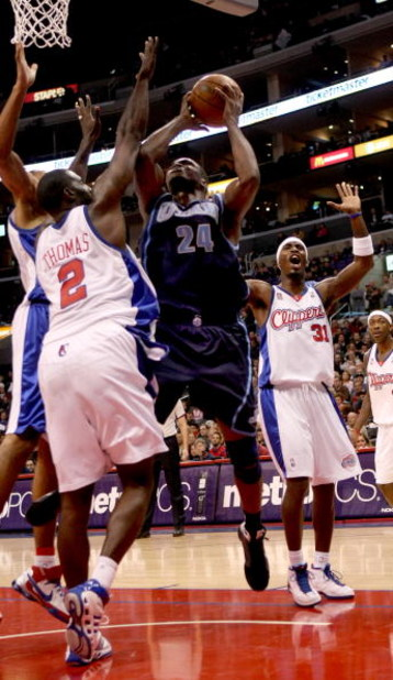 LOS ANGELES, CA - NOVEMBER 03:  Paul Millsap #24 of the Utah Jazz shoots over Tim Thomas #2 of the Los Angeles Clippers on November 3, 2008 at Staples Center in Los Angeles, California. The Jazz won 89-73.  NOTE TO USER: User expressly acknowledges and ag