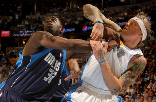DENVER - MAY 13:  Chris Andersen #11 of the Denver Nuggets and Brandon Bass #32 of the Dallas Mavericks battle for position in Game Five of the Western Conference Semifinals during the 2009 NBA Playoffs at Pepsi Center on May 13, 2009 in Denver, Colorado.