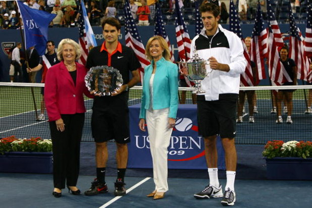 NEW YORK - SEPTEMBER 14:  (L-R) USTA president Lucy S. Garvin, Roger Federer of Switzerland and Juan Martin Del Potro of Argentina pose with the trophies after the Men's Singles final on day fifteen of the 2009 U.S. Open at the USTA Billie Jean King Natio