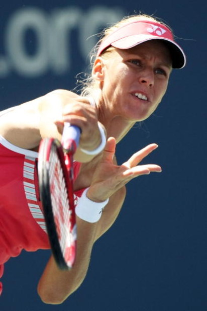 NEW YORK - SEPTEMBER 03:  Elena Dementieva of Russia serves against Melanie Oudin during day four of the 2009 U.S. Open at the USTA Billie Jean King National Tennis Center on September 3, 2009 in Flushing neighborhood of the Queens borough of New York Cit