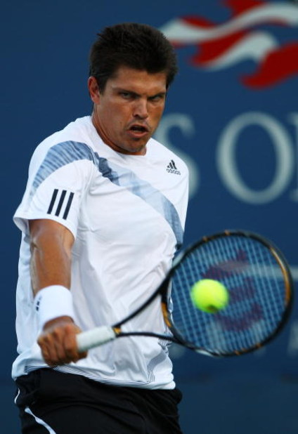 NEW YORK - SEPTEMBER 01:  Taylor Dent of the United States returns a shot against Feliciano Lopez of Spain during day two of the 2009 U.S. Open at the USTA Billie Jean King National Tennis Center on September 1, 2009 in Flushing neighborhood of the Queens