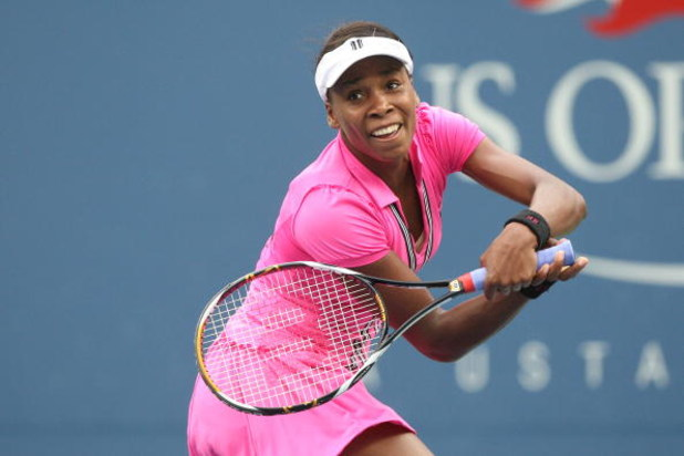 NEW YORK - SEPTEMBER 06:  Venus Williams of the United States returns a shot against Kim Clijsters of Belgium during day seven of the 2009 U.S. Open at the USTA Billie Jean King National Tennis Center on September 6, 2009 in the Flushing neighborhood of t