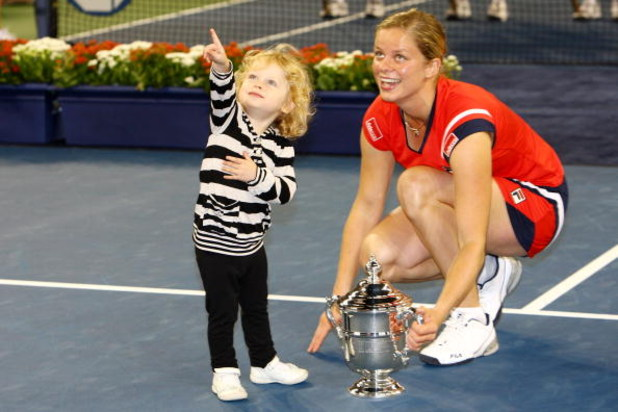 NEW YORK - SEPTEMBER 13:  Kim Clijsters of Belgium and daughter Jada pose with the championship trophy after Clijsters defeated Caroline Wozniacki of Denmark in the Women�s Singles final on day fourteen of the 2009 U.S. Open at the USTA Billie Jean King N