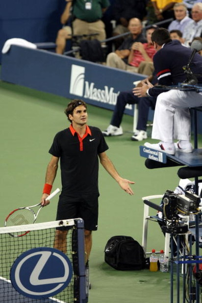NEW YORK - SEPTEMBER 14:  Roger Federer of Switzerland (L) disputes a call in the fourth set tiebreak to chair judge Jake Garner during the Men�s Singles final on day fifteen of the 2009 U.S. Open at the USTA Billie Jean King National Tennis Center on Sep