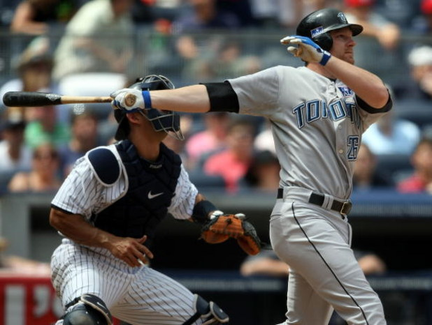NEW YORK - JULY 04: Adam Lind #26 of the Toronto Blue Jays hits a two run home run in the sixth inning against the New York Yankees on July 4, 2009 at Yankee Stadium in the Bronx borough of New York City.  (Photo by Nick Laham/Getty Images)