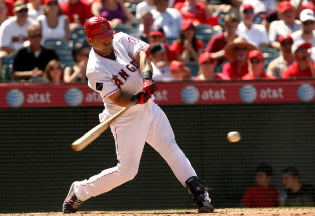 ANAHEIM, CA - AUGUST 12:  Kendry Morales #19 of the Los Angeles Angels of Anaheim bats against the Tampa Bay Rays on August 12, 2009 at Angel Stadium in Anaheim, California.  The Angels won 10-5.  (Photo by Stephen Dunn/Getty Images)