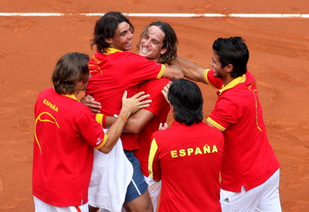 MADRID, SPAIN - SEPTEMBER 21:  Spanish Davis Cup team members (L-R) David Ferrer, Rafael Nadal, Feliciano Lopez,  Fernando Verdasco (Bottem C), Davis Cup coach Emilio Sanchez Vicario and David Ferrer celebrate at the end of the third and final day of the